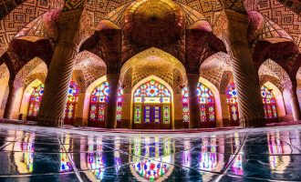 Mosque built in Persian Architecture, with beautiful painting on the glass doors and windows, the architechtural designs giving a royal look.